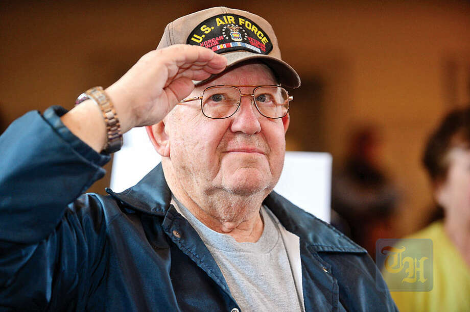 Hour photo / Erik Trautmann Air Force Veteran Joe Witkowski salutes during The Official Air Force Service Song The Norwalk Veterans Memorial Committee holds their 2015 Veterans Day Ceremony Wednesday at the Norwalk Concert Hall.