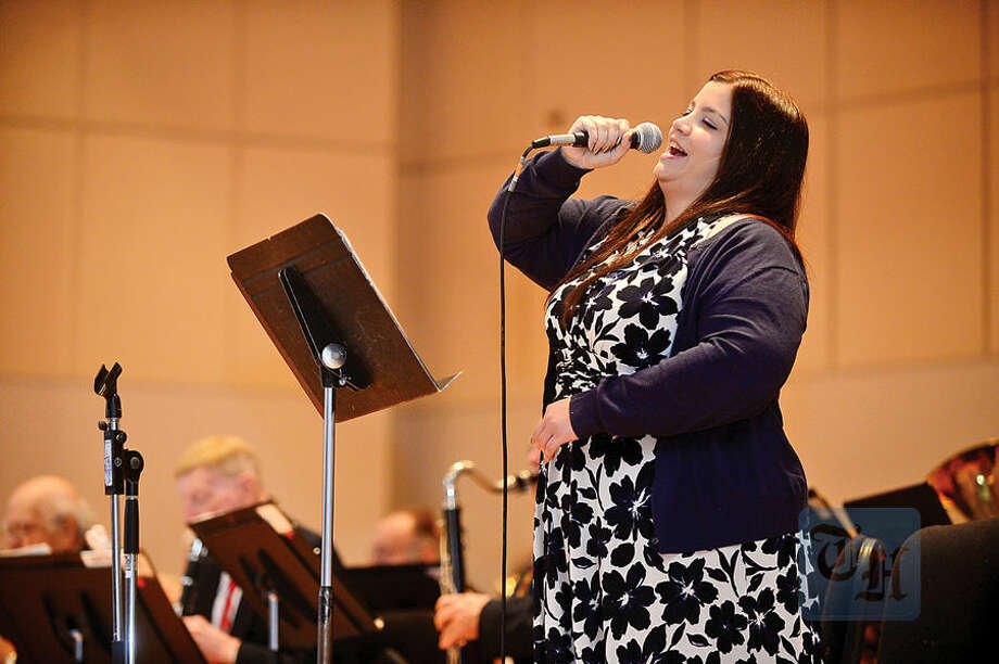 Hour photo / Erik Trautmann Alison faye sings as the American Festival Band plays America the Beautiful during The Norwalk Veterans Memorial Committee 2015 Veterans Day Ceremony Wednesday at the Norwalk Concert Hall.