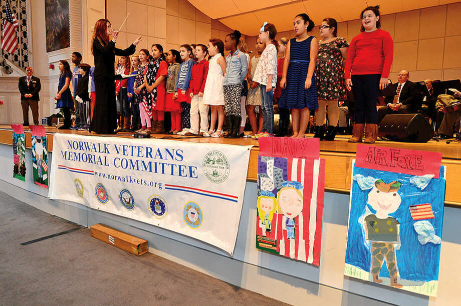 Hour photo / Erik Trautmann Lisa Murray directs the Columbus Magnet School Choir as The Norwalk Veterans Memorial Committee holds their 2015 Veterans Day Ceremony Wednesday at the Norwalk Concert Hall.