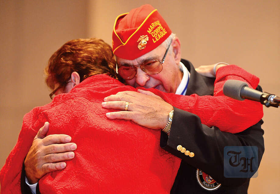 Hour photo / Erik Trautmann Committee Chairman Dan Caporale is thanked for his service for Secretary Karen Doyle Lyons as the Norwalk Veterans Memorial Committee holds their 2015 Veterans Day Ceremony Wednesday at the Norwalk Concert Hall.