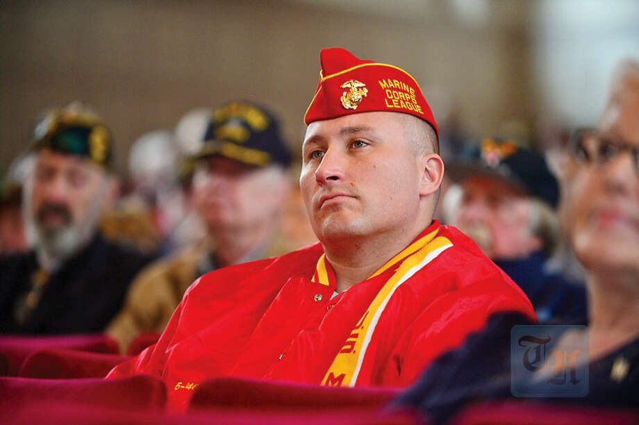 Hour photo / Erik Trautmann Marine Veteran Garberra TJ Garberra listens to The Norwalk Veterans Memorial Committee 2015 Veterans Day Ceremony Wednesday at the Norwalk Concert Hall.