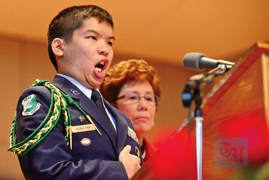Hour photo / Erik Trautmann Norwalk Air Force JROTC Commander james Hobayan sings the National Anthem as The Norwalk Veterans Memorial Committee holds their 2015 Veterans Day Ceremony Wednesday at the Norwalk Concert Hall.