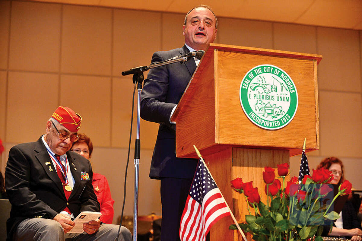 Hour photo / Erik Trautmann Former State Representative Larry Cafero gives the keynote address at The Norwalk Veterans Memorial Committee 2015 Veterans Day Ceremony Wednesday at the Norwalk Concert Hall.