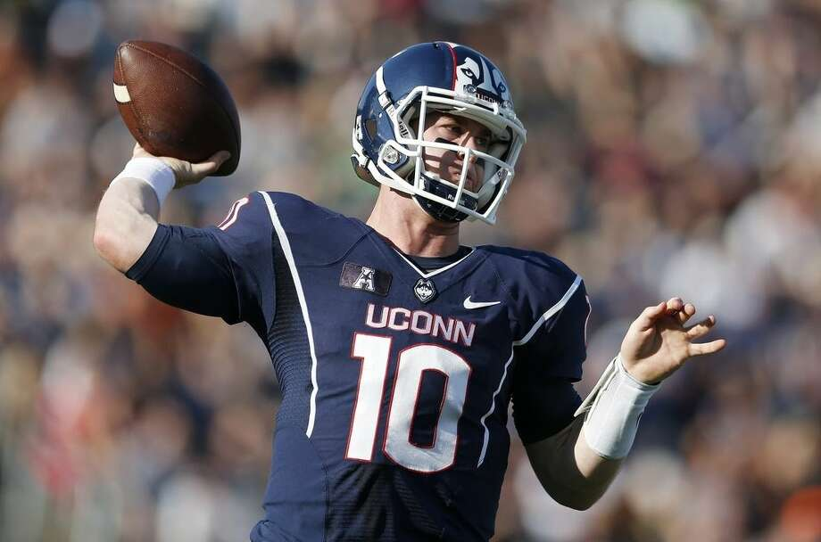 Connecticut quarterback Chandler Whitmer passes during the first quarter of an NCAA college football game against Temple in East Hartford, Conn., Saturday, Sept. 27, 2014. (AP Photo/Michael Dwyer)