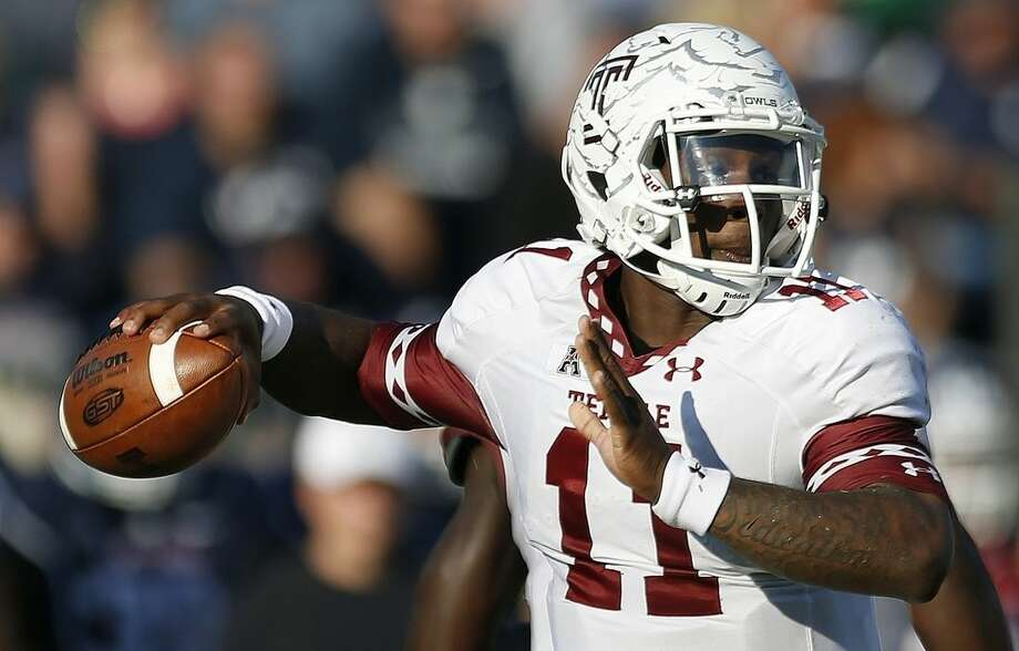 Temple quarterback P.J. Walker (11) looks to pass during the second quarter of an NCAA college football game against Connecticut in East Hartford, Conn., Saturday, Sept. 27, 2014. (AP Photo/Michael Dwyer)