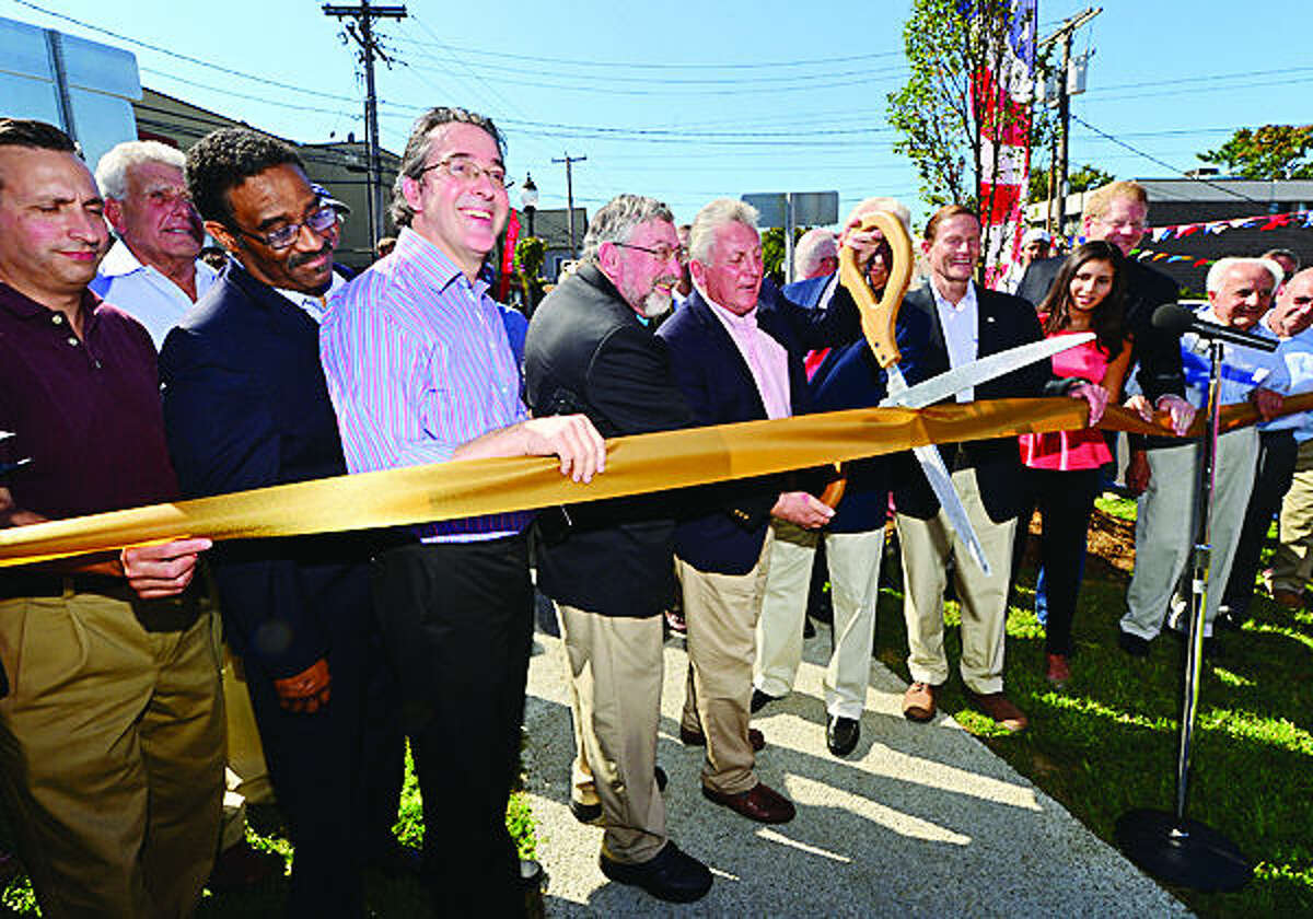 Hour photo / Erik Trautmann Jim Clark, Vice President of the Golden Hill Neighborhood Association, 3rd from left, is joined by dignitaires including Norwalk Mayor Harry Rilling, former mayors Knopp and Moccia as well as US Senator Dick Blumenthal, for a ribbon cutting ceremony for the new Cedar St Grand Opening Saturday afternoon.