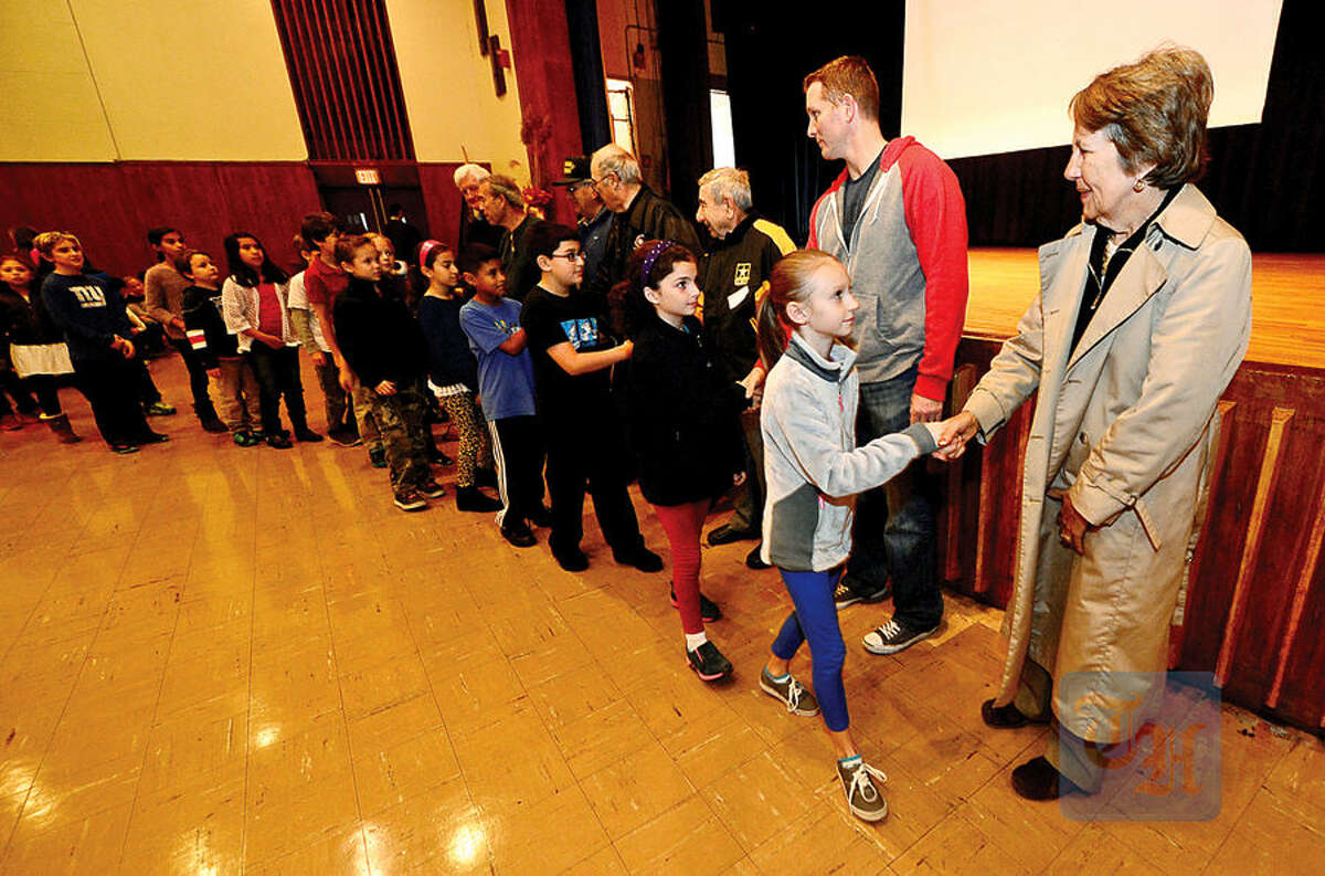 Hour photo / Erik Trautmann All Saints Catholic School students thank the veterans that attended the school's annual Veteran's Day assembly Wednesday.