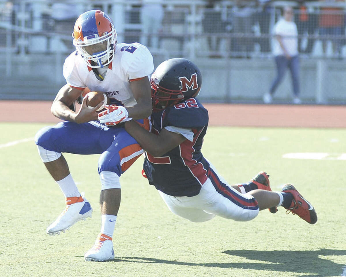 Hour photo/John Nash McMahon's Roshad Green-Younger (62) sacks Danbury quarterback Anferny Ith during the fourth quarter of Saturday's Homecoming Day win over the Hatters at Casagrande Field. The Senators won, 44-28.