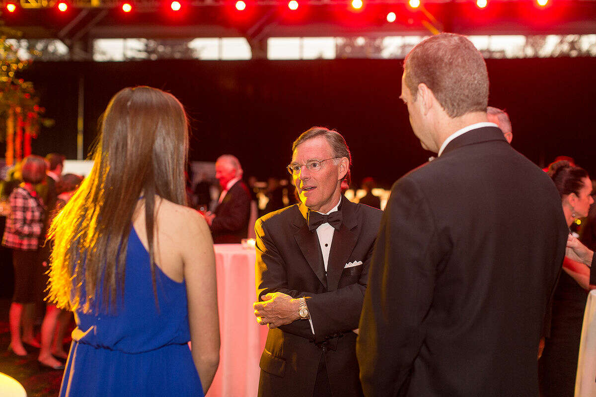 """Hour Photo / DAVID ESPOSITO Harold """"Terry"""" McGraw III, converses with Nicole DeBarba and her father, Dan DeBarba, Senior Vice President and Chief Operating Officer at Norwalk Hospital at the Norwalk Hospital Gala Saturday evening."""