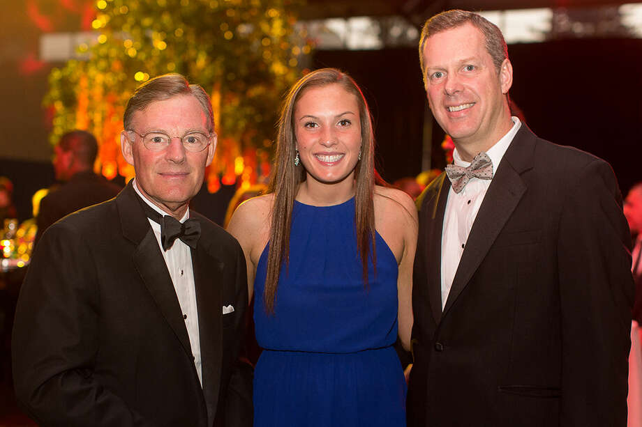 "Hour Photo / DAVID ESPOSITO Harold ""Terry"" McGraw III, Nicole DeBarba and her father, Dan DeBarba, Senior Vice President and Chief Operating Officer at Norwalk Hospital gather for a photo at the Norwalk Hospital Gala Saturday evening."