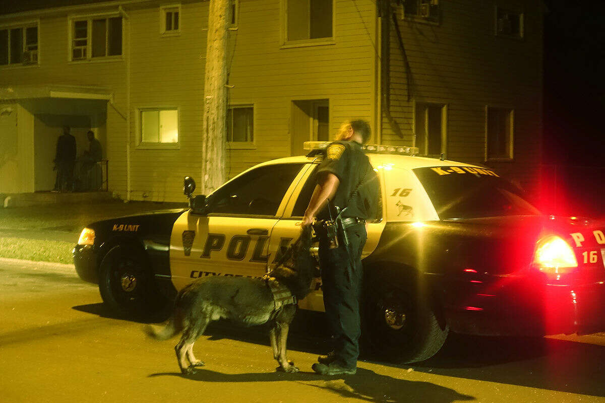 Hour photo/Jeff Dale Norwalk Police investigate a shooting at Colonial Village after a male victim was shot in the leg.