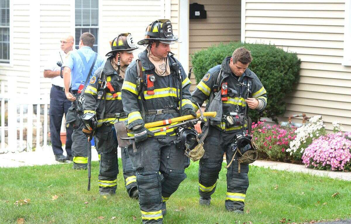 Hour Photo/Alex von Kleydorff Firefighters leave 16 Bayview Ave. on Wednesday evening after extinguishing a fire on the second floor of a multi family house.