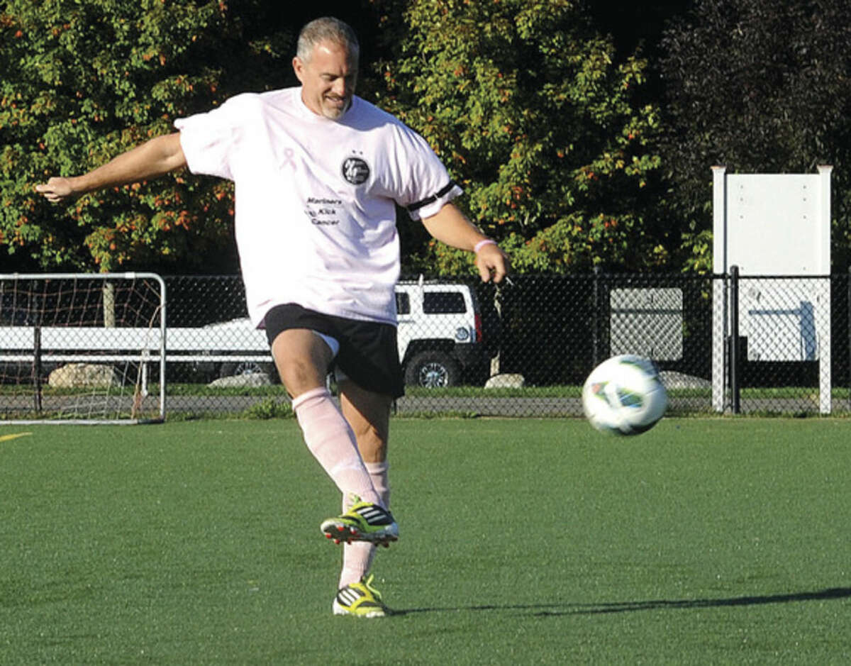 Hour photo/Matthew Vinci Al Boccanfuso with The Norwalk Mariners Over-40 men's soccer team. Devoting its next four games to the awareness of breast cancer. They will be wearing pink uniforms, using a pink soccer ball.