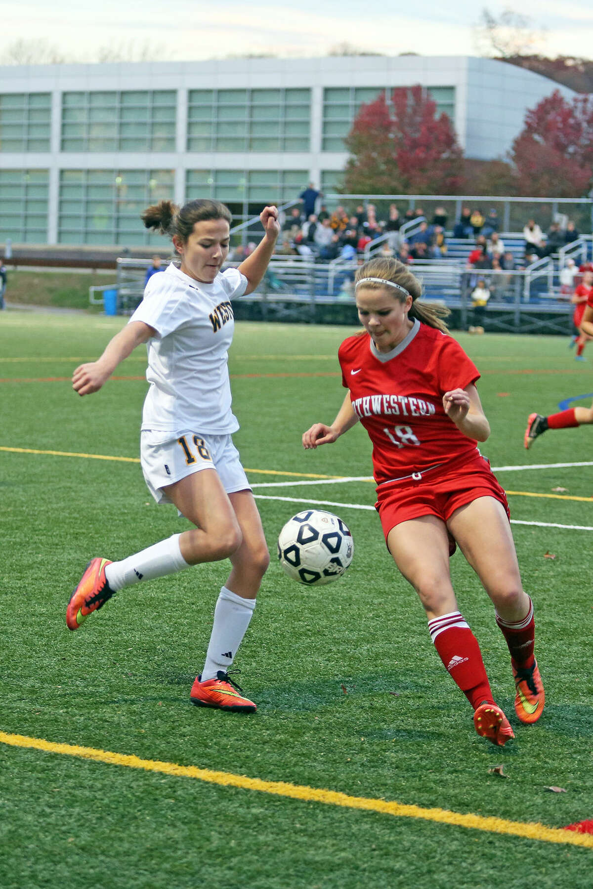 Weston's #18, Emily Iatesta, kicks the ball during the Class M state tournament game against Northwestern at the Weston High School girl's soccer field Monday afternoon. Hour Photo / Danielle Calloway