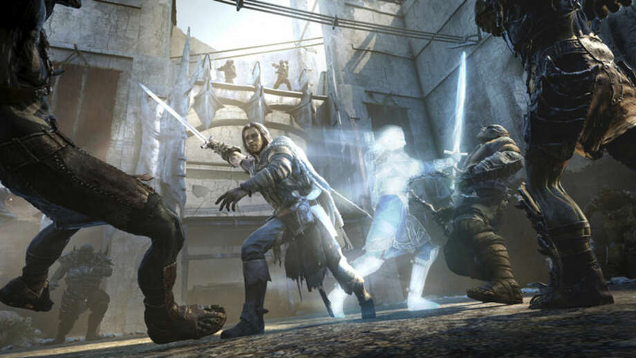 """This image released by Warner Bros. Entertainment shows a ranger named Talion and his ghostly companion invading an orc fortress in a scene from video game """"Middle-earth: Shadow of Mordor."""" (AP Photo/Warner Bros. Entertainment)"""