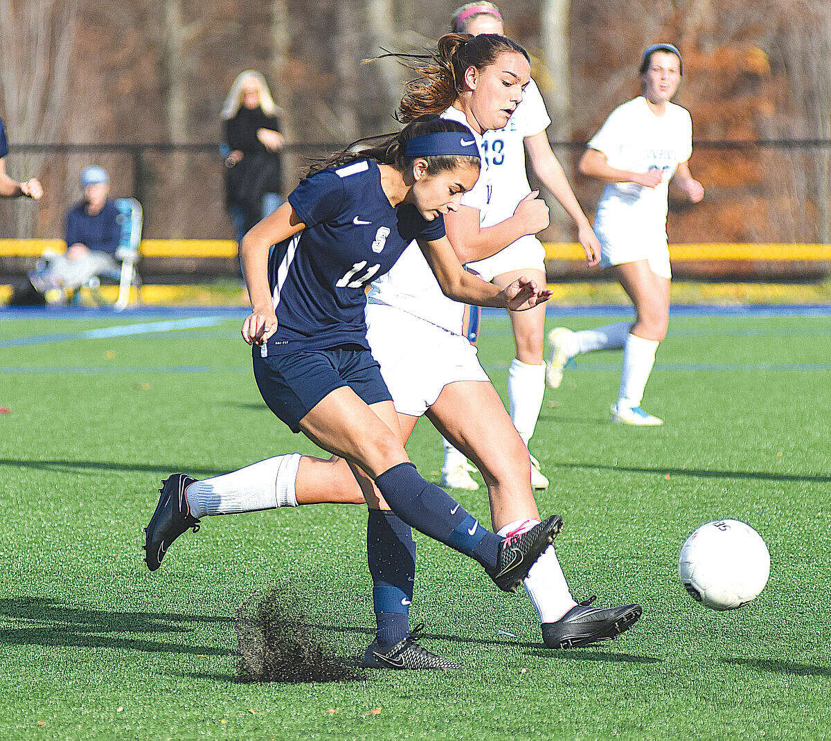 Hour photo/John Nash Staples' Tia Zajec, front, steps in front of a Darien player to boot the ball up the field.