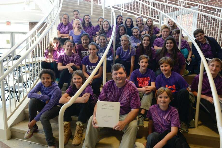 Contributed photoMike Gibbs, 7th grade Social Studies teacher at Middlesex Middle School with Purple Team students.
