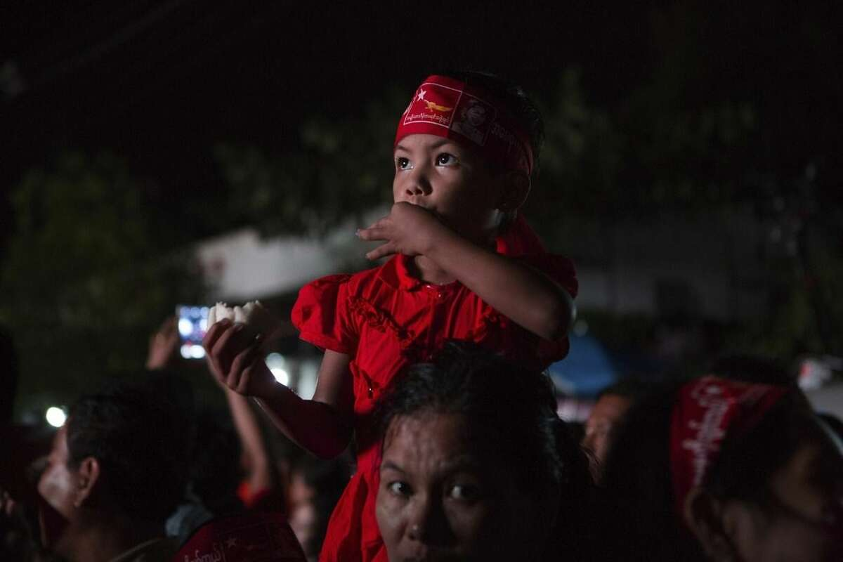 Supporters of Myanmar's National League for Democracy party gather for election results outside the NLD headquarters in Yangon, Myanmar, Monday, Nov. 9, 2015. With tremendous excitement and hope, millions of citizens voted Sunday, Nov. 8 in Myanmar's historic general election that will test whether the military's long-standing grip on power can be loosened, with opposition leader Aung San Suu Kyi's party expected to secure an easy victory. (AP Photo/Amanda Mustard)
