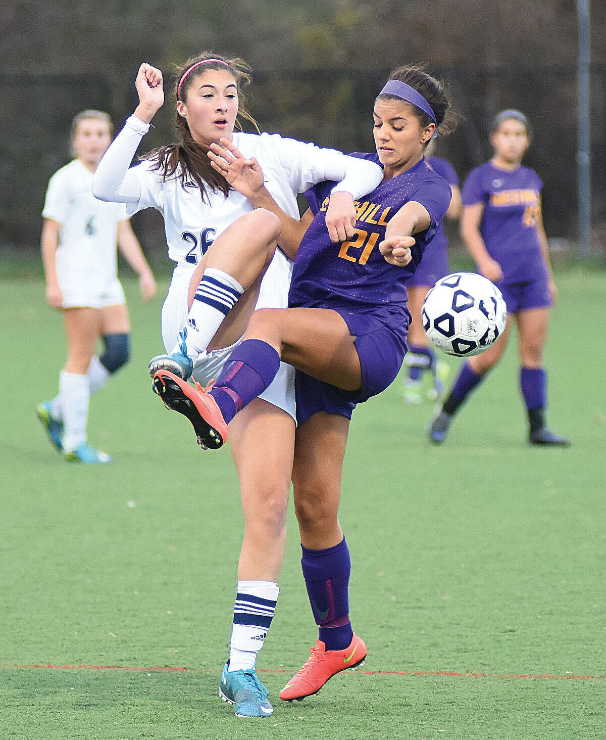 Hour photo/John Nash Wilton's Ashley Vitarelli and Westhill's Nicole Pipera fight for the ball on Monday.