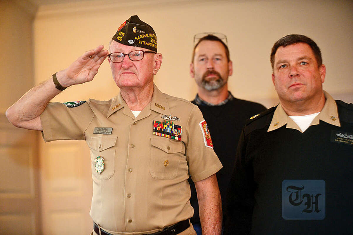 Hour photo / Erik Trautmann Navy Vetran Donald Burrows and Brien McMahon Army JROTC Commander David Pascoe stand at attention as The Norwalk Veterans Memorial Committee holds their 2015 Veterans Day Ceremony Wednesday at the Norwalk Concert Hall.