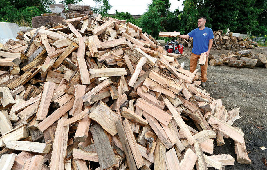 Hour photo / Erik Trautmann Norwalk Recreation and Parks Superintendent Ken Hughes has begun a new program to sell split, seasoned firewood to residents from city wood that used to be discarded at a cost.