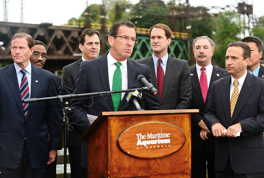 Hour photo / Erik Trautmann Governor Dannel P. Malloy holds a news conference in Norwalk Thursday morning to highlight the planned replacement of the Walk Bridge, the 118-year old bridge that serves on Metro-North's New Haven Line. U.S. Senator Richard Blumenthal, Congressman Jim Himes, Mayor Harry W. Rilling, State Senator Bob Duff, Department of Transportation Commissioner James P. Redeker, Connecticut Commuter Rail Council Vice Chairman John Hartwell, commuter advocate Jim Cameron, and other local officials joined the governor in the announcement.