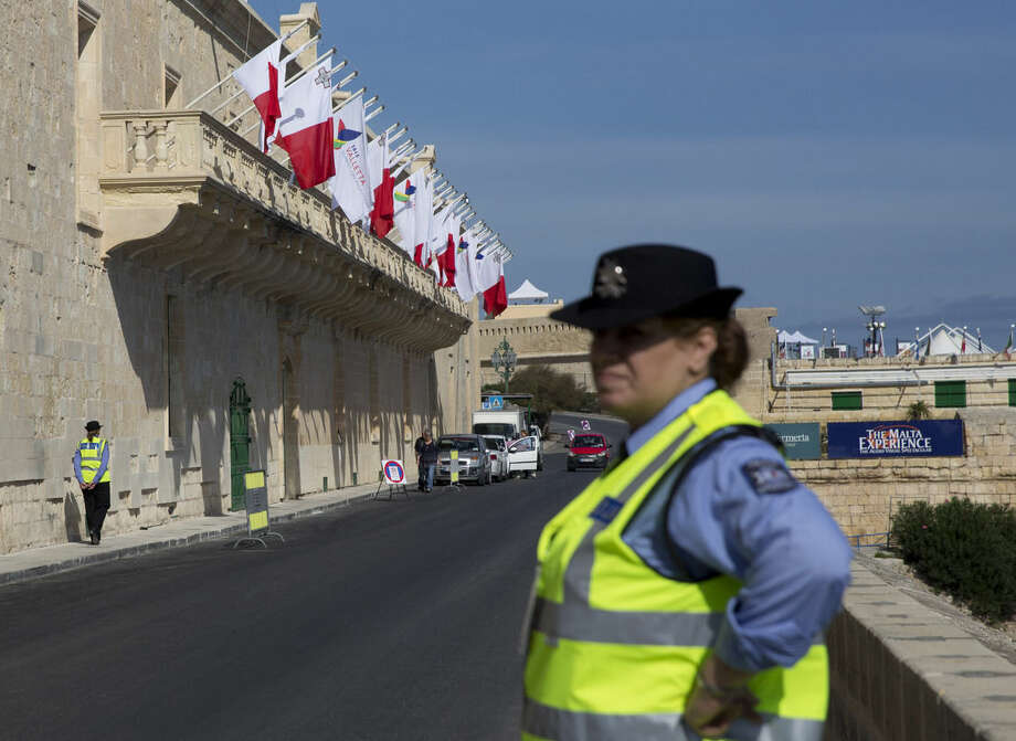 Police officers patrol outside the Mediterranean Conference Centre where an informal European Union and African leaders summit on migration will be held in Valletta, Malta, Wednesday, Nov. 11, 2015. The meeting of leaders is to map strategy to beef up development project aid in Africa and set up mechanisms to repatriate migrants Europe says don't deserve its protection. (AP Photo/Alessandra Tarantino)