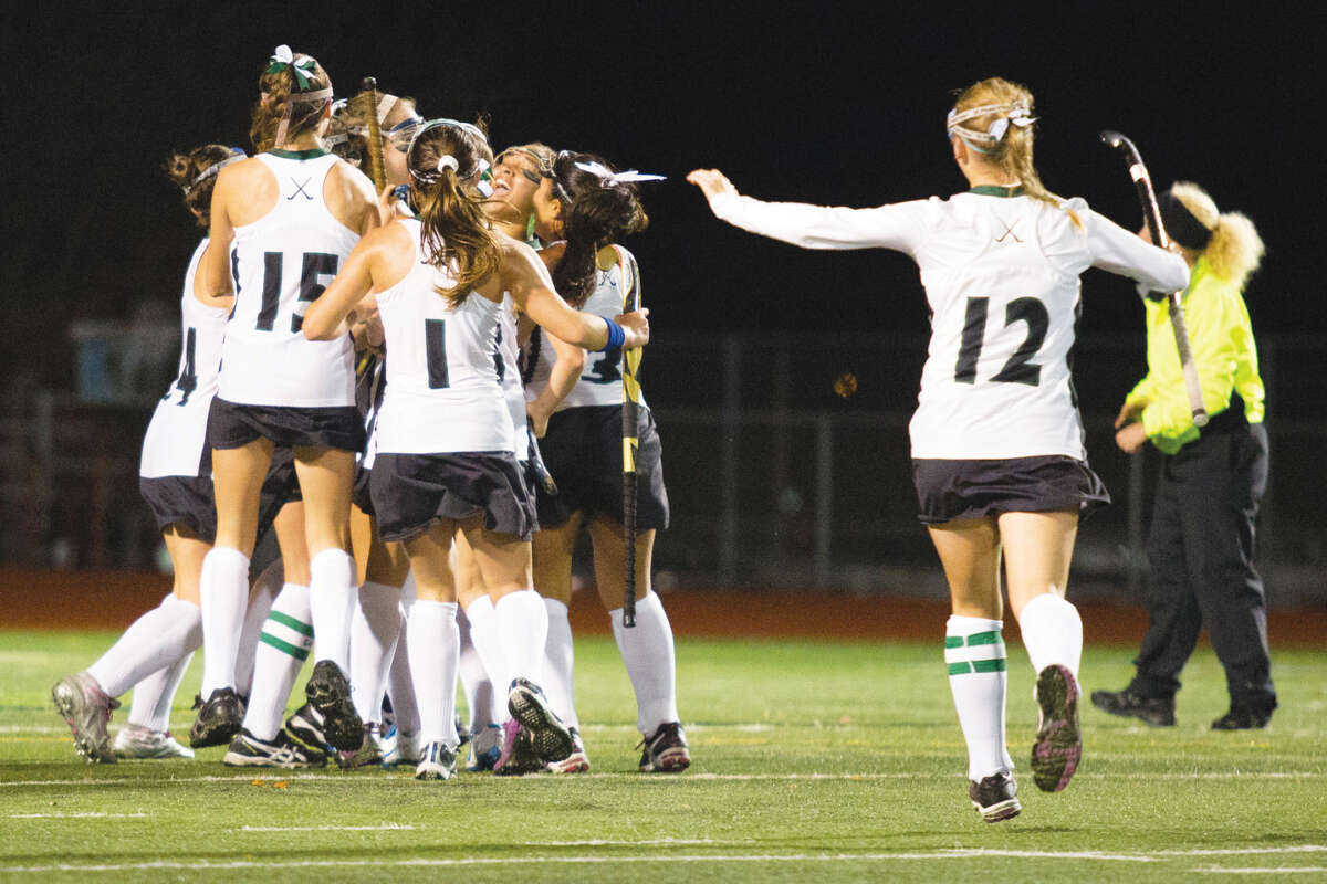 Hour pholto/Chris Palermo. Norwalk celebrates after Sarah Roddy's game winning goal against Trumbull in the girls field hockey state tournament game Wednesday night.