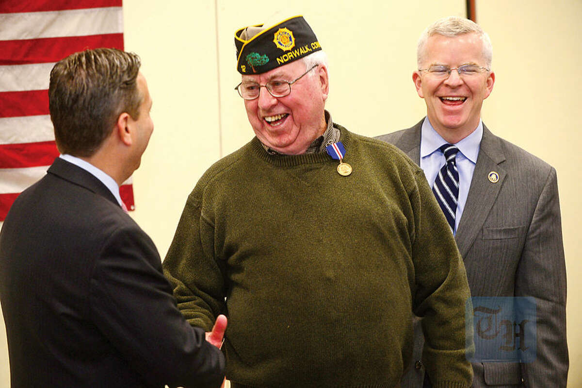 Hour photo / Erik Trautmann Over 75 veterans from the greater Norwalk area are presented the 'Connecticut Wartime Service Medal' by State Senate Majority Leader, Bob Duff, and the Connecticut Veterans Affairs Commissioner, Sean Connolly, during a ceremony at the Norwalk Public Library Main Branch Thursday.