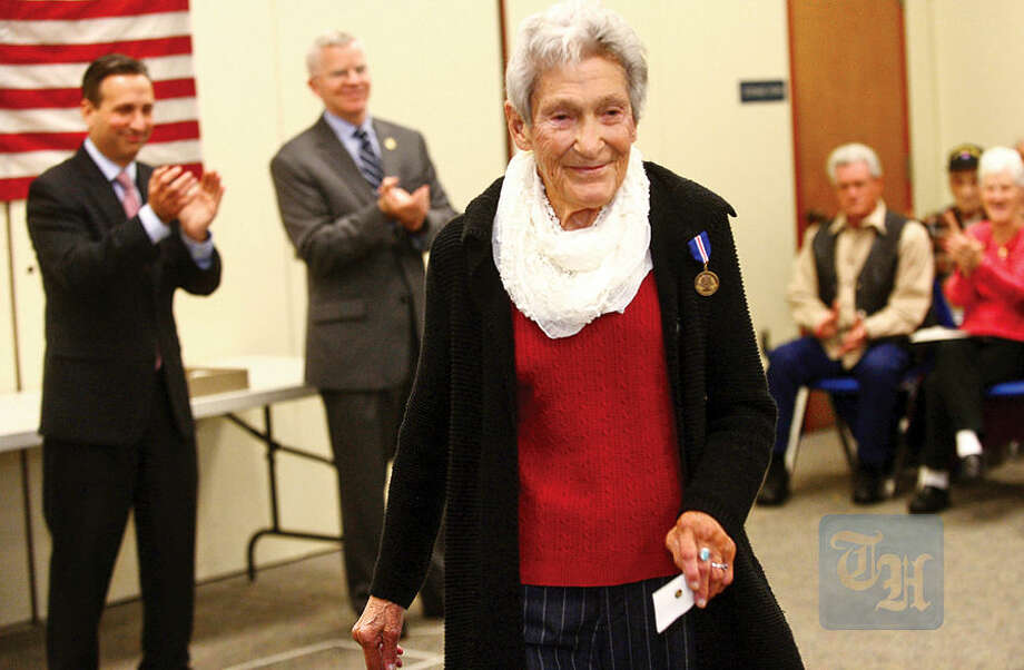 Hour photo / Erik Trautmann Over 75 veterans from the greater Norwalk area including Florence Gordon are presented the 'Connecticut Wartime Service Medal' by State Senate Majority Leader, Bob Duff, and the Connecticut Veterans Affairs Commissioner, Sean Connolly, during a ceremony at the Norwalk Public Library Main Branch Thursday.