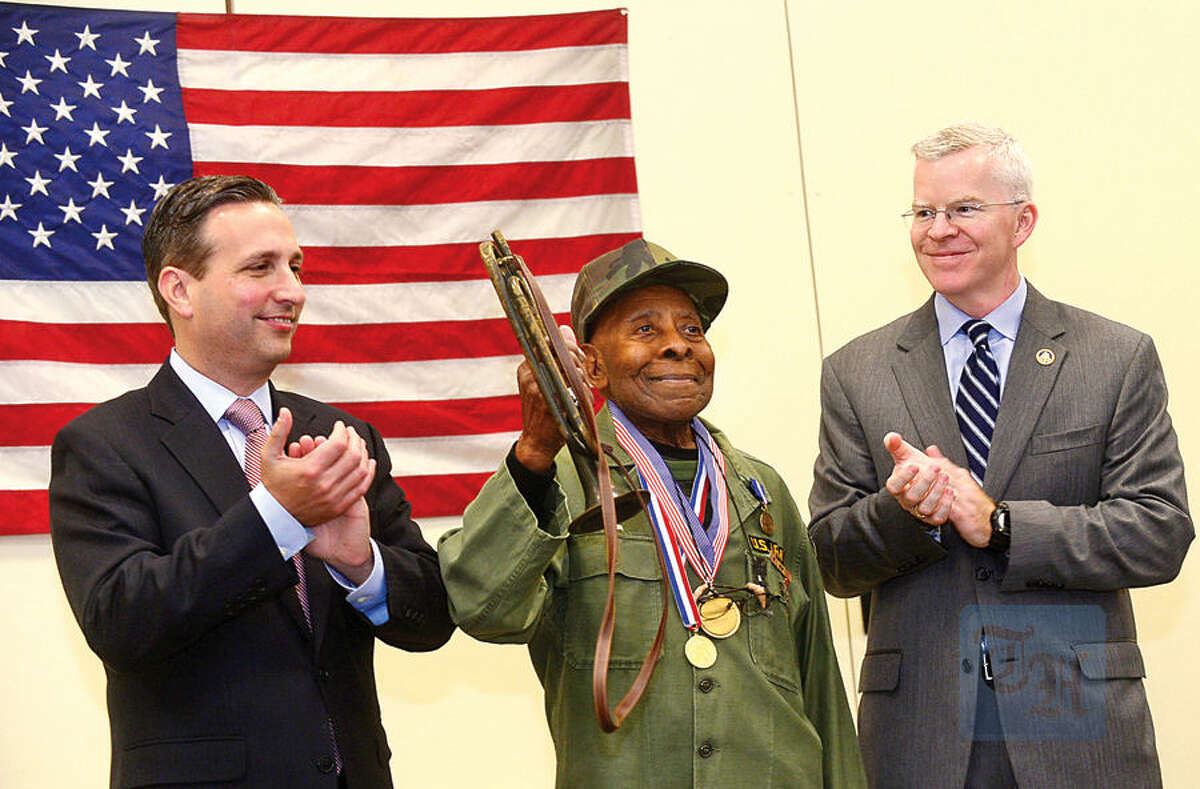 Hour photo / Erik Trautmann Over 75 veterans from the greater Norwalk area including Charles Roy are presented the 'Connecticut Wartime Service Medal' by State Senate Majority Leader, Bob Duff, and the Connecticut Veterans Affairs Commissioner, Sean Connolly, during a ceremony at the Norwalk Public Library Main Branch Thursday.