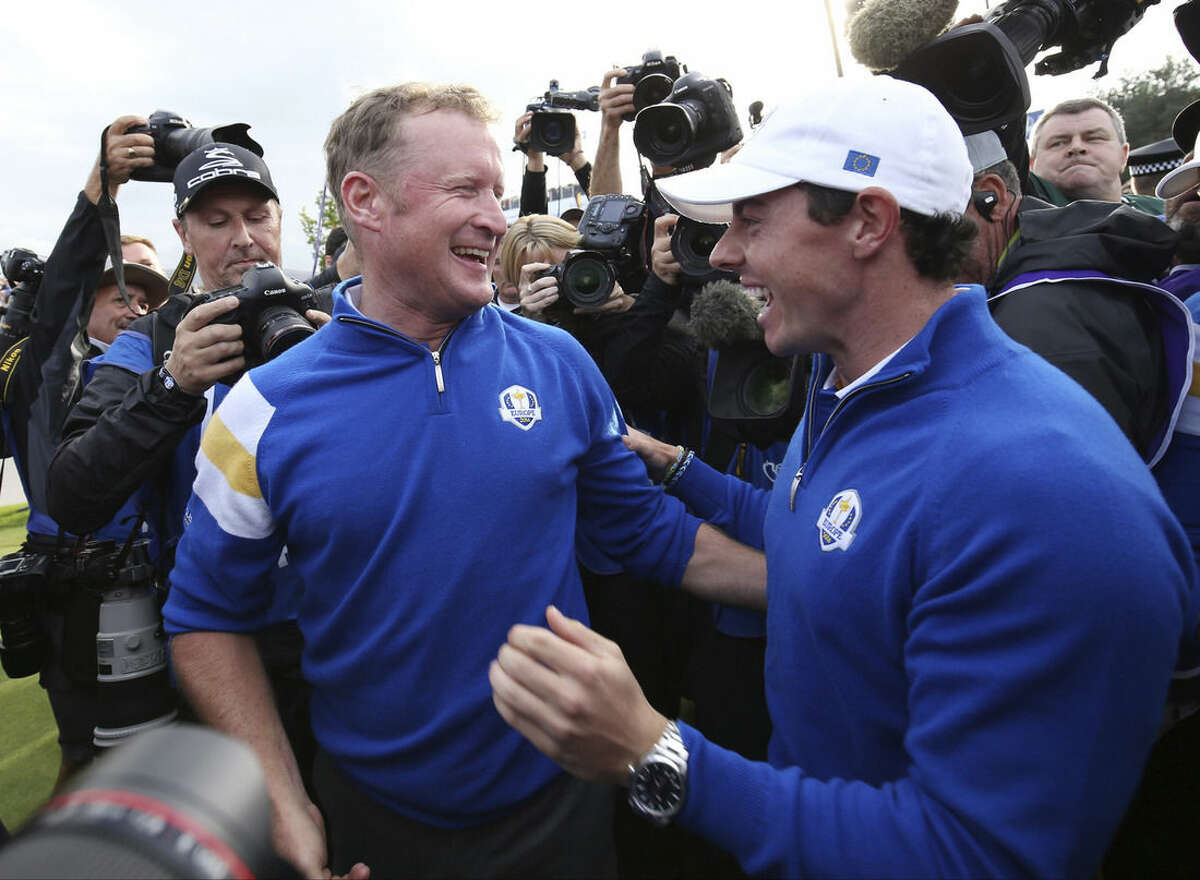 Europe's Jamie Donaldson, left, and Rory McIlroy celebrate winning the 2014 Ryder Cup golf tournament at Gleneagles, Scotland, Sunday, Sept. 28, 2014. (AP Photo/Peter Morrison)