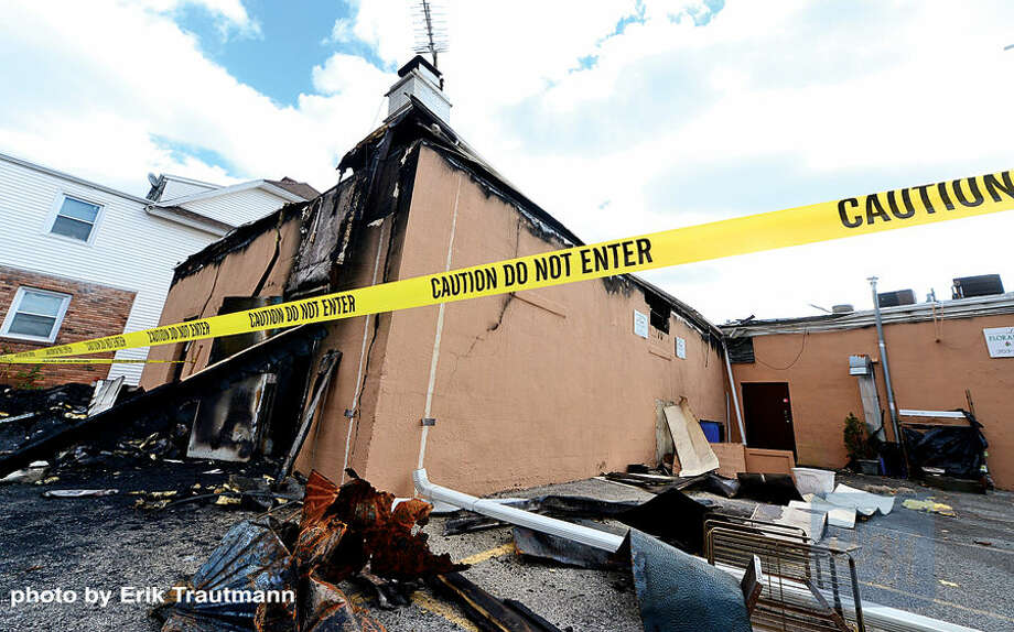 Hour photo / Erik Trautmann The Ludlowe Shooping Centre in East Norwalk was damaged by a devastating fire Thursday afternoon.