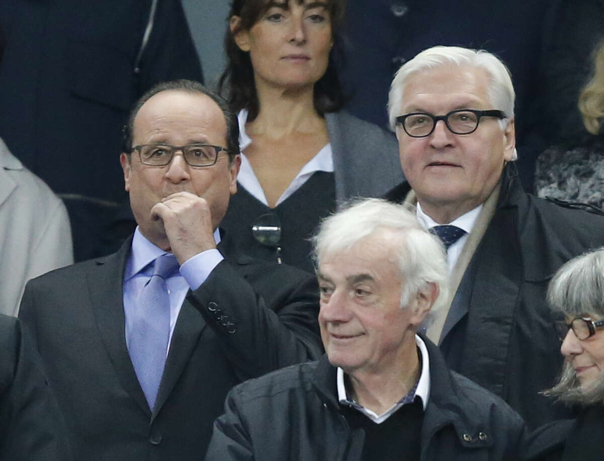 French President Francois Hollande, left, and German Foreign Minister Frank-Walter Steinmeier arrive to watch the international friendly soccer match France against Germany at the Stade de France stadium in Saint Denis, outside Paris, Friday Nov. 13, 2015. Several dozen people were killed in attacks around Paris on Friday, French President Francois Hollande said, announcing that he was closing the country's borders and declaring a state of emergency. (AP Photo/Michel Euler)