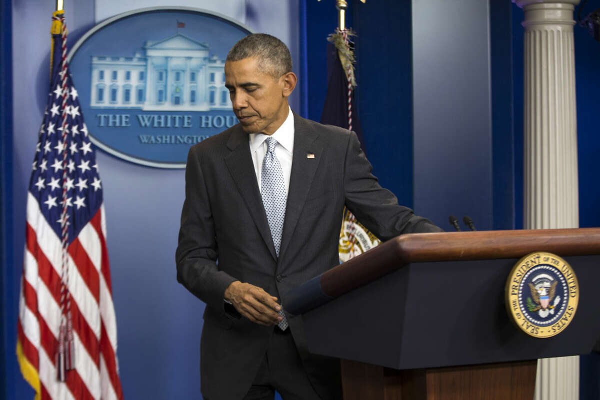 President Barack Obama walks from the podium after speaking about attacks in Paris from the briefing room of the White House, on Friday, Nov. 13, 2015, in Washington. Obama is calling the attacks on Paris an