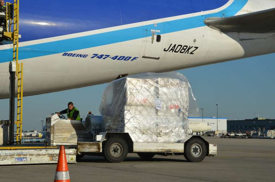 AmeriCares relief supplies are loaded onto a cargo plane at O'Hare International Airport in Chicago on Tuesday, Sept. 23 as part of a humanitarian aid flight organized by Airlink.