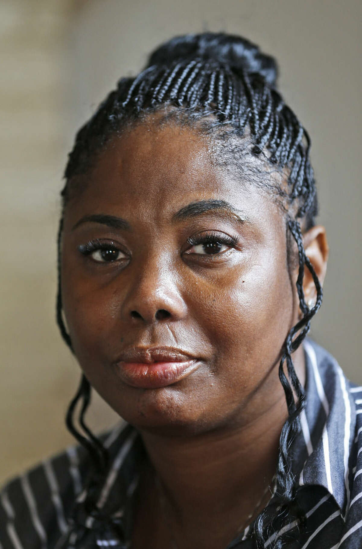 Gwendolyn Smalls poses in her home in Richmond, Va., Thursday, Nov. 12, 2015. Smalls' brother, Linwood R. Lambert Jr., died in police custody in May of 2013 after being repeatedly stunned by South Boston police. Lambert's family filed a $25 million lawsuit in April, accusing the officers of unlawfully arresting him and using
