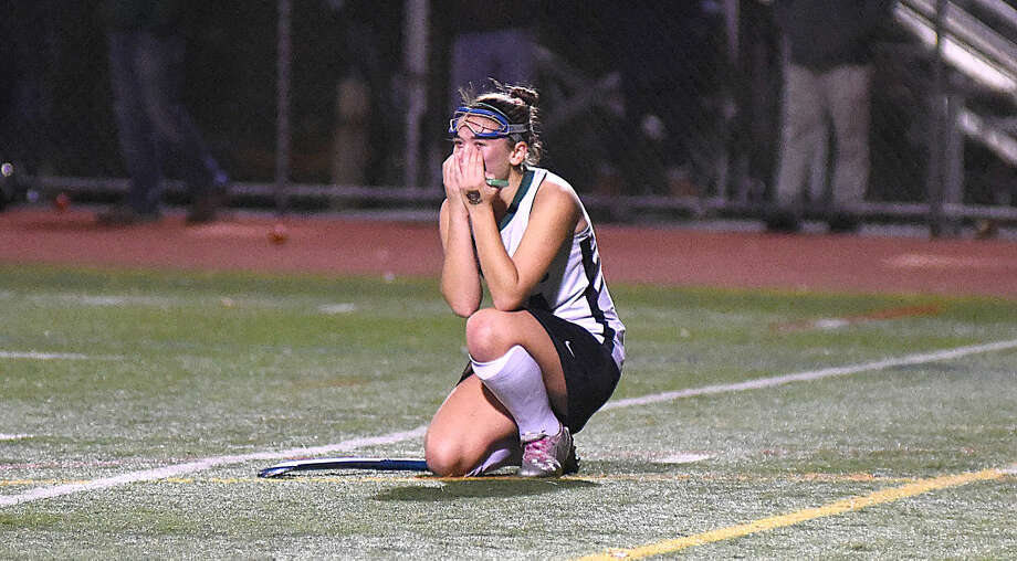 Hour photo/John Nash - Norwalk's Kaitlin Uralowich reacts at the end of her team's 1-0 Class L quarterfinal field hockey loss to Cheshire on Friday night at Testa Field.