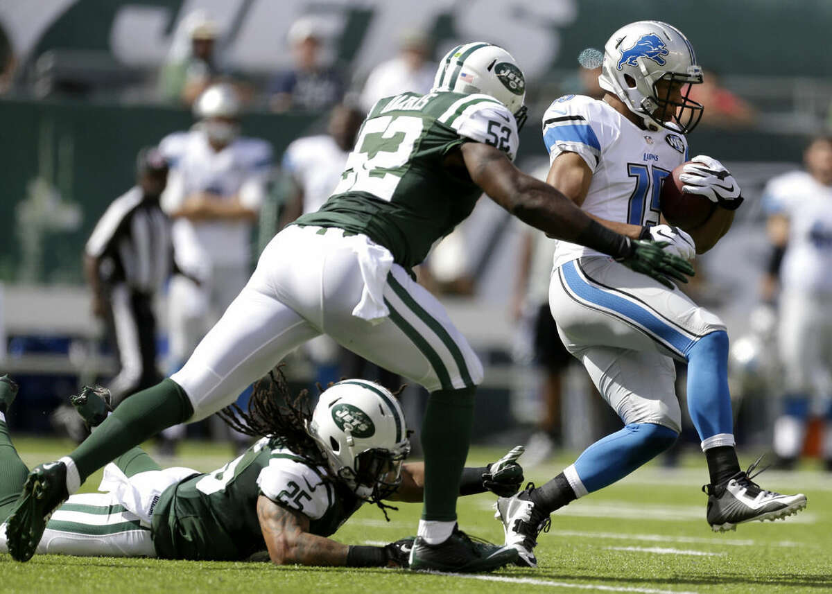 Detroit Lions wide receiver Golden Tate, right, runs against New York Jets inside linebacker David Harris (52) and free safety Calvin Pryor (25) during the first half of an NFL football game, Sunday, Sept. 28, 2014, in East Rutherford, N.J. (AP Photo/Frank Franklin II)