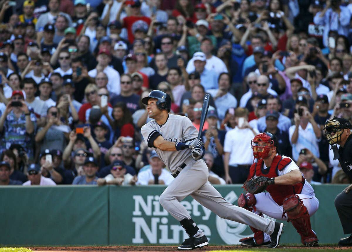 New York Yankees designated hitter Derek Jeter follows through on a single in the third inning against the Boston Red Sox in a baseball game Sunday, Sept. 28, 2014, in Boston. It is the last baseball game of Jeter's career. (AP Photo/Elise Amendola)