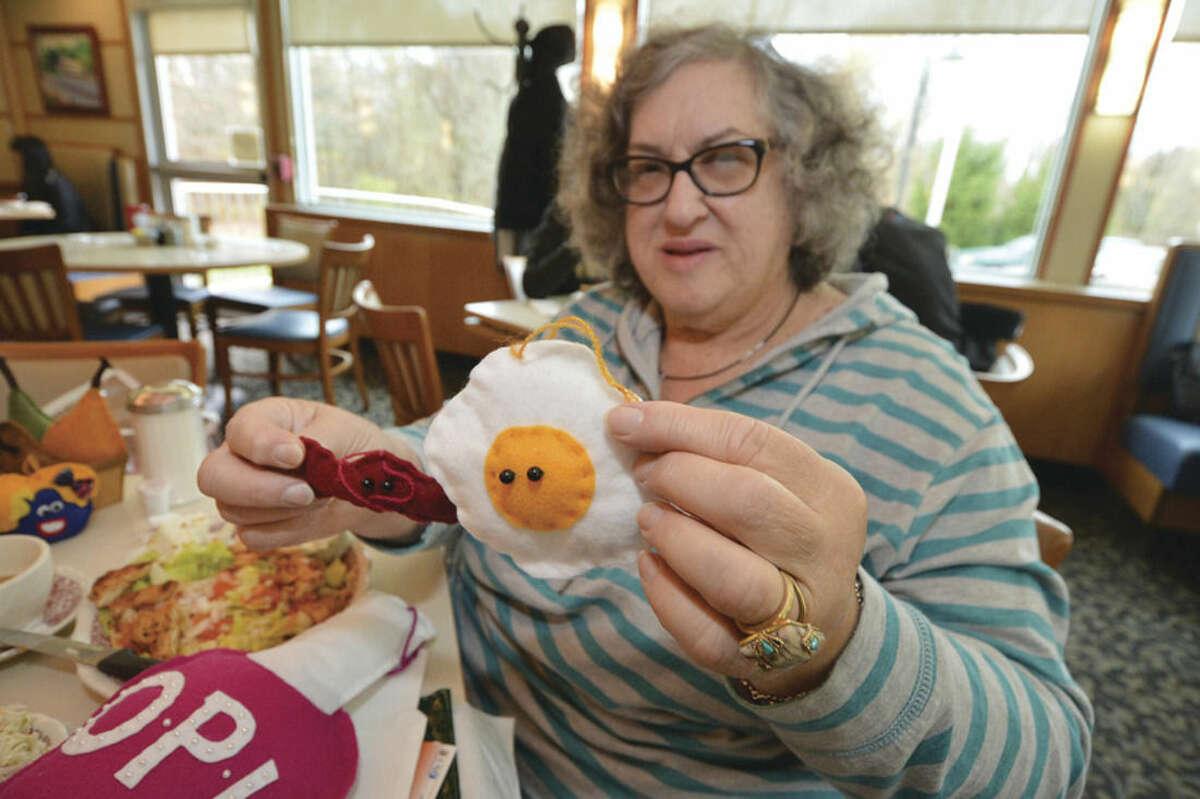 """Hour photo/Alex von Kleydorff Artist Barbara Spiegel displays some of her food creations such as """"bacon and eggs."""""""
