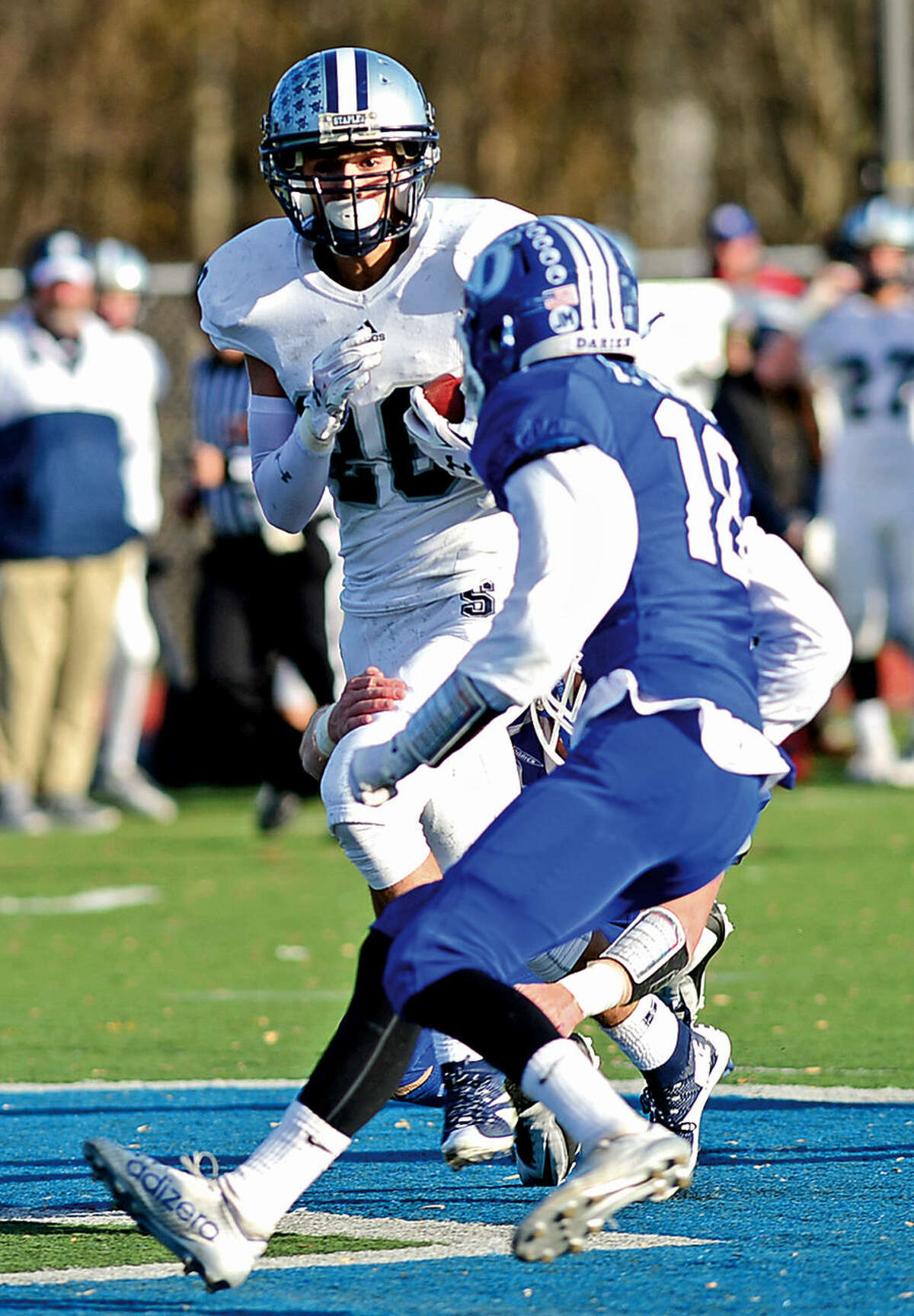 Hour photo / Erik Trautmann Elliot Pouilley of Staples tries to move the ball up field after a reception during a devastating defeat by Darien High School Saturday in Darien.