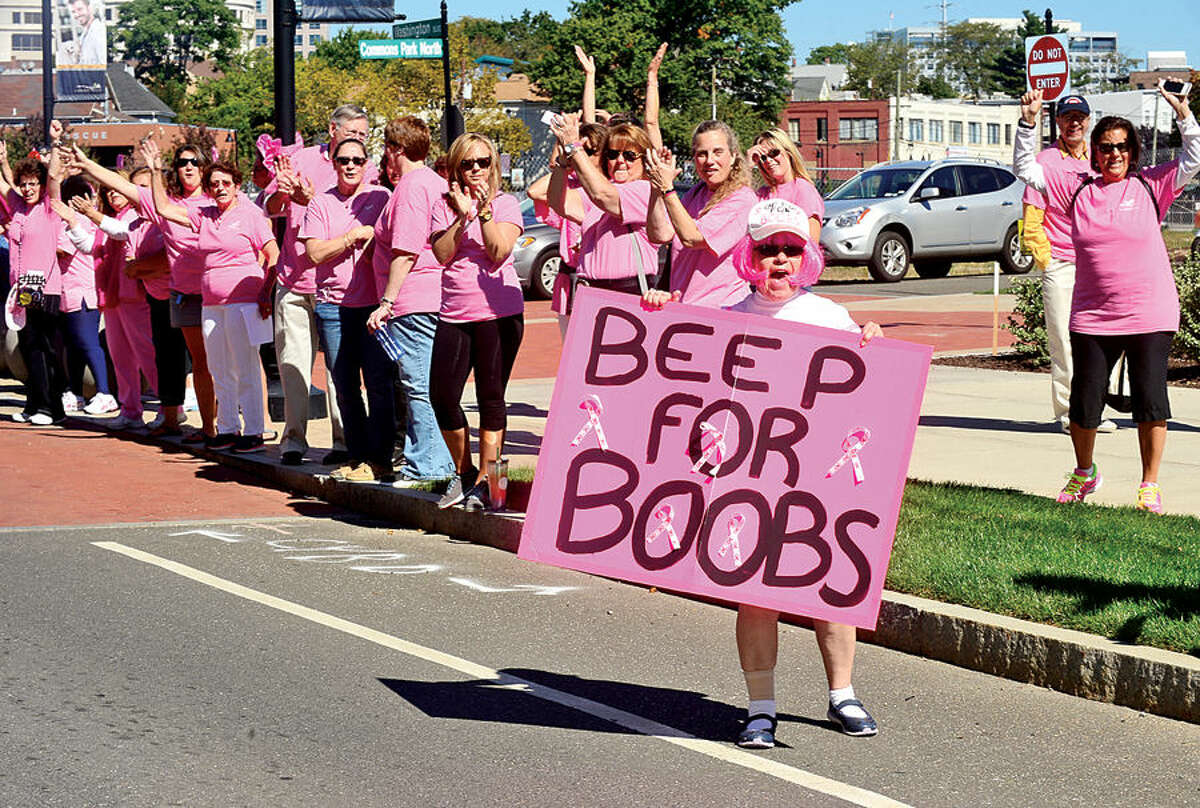 """Karen Sabia leads local breast cancer survivors and supporters as they stand in support of Stamford Hospital's """"Paint the Town Pink"""" campaign in Commons Park at Harbor Point Saturday."""