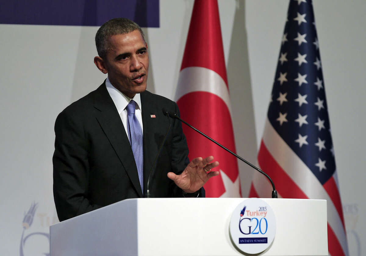 U.S. President Barack Obama talks during a news conference at the end of the G-20 summit in Antalya, Turkey, Monday, Nov. 16, 2015. The leaders of the Group of 20 wrapped up their two-day summit near the Turkish Mediterranean coastal city of Antalya Monday against the backdrop of heavy French bombardment of the Islamic State's stronghold in Syria. The bombings marked a significant escalation of France's role in the fight against the extremist group. (AP Photo/Mehmet Guzel)