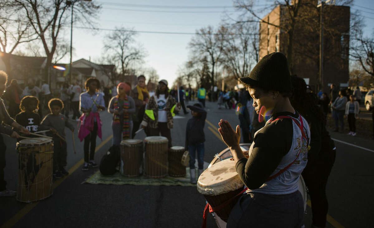 Members of the Voice of Culture drum group energized the crowd as they blocked off Plymouth Ave. N to create a