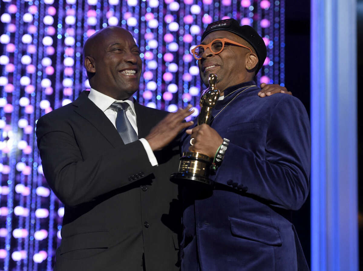 John Singleton, left, and Spike Lee, honorary Oscar recipient, pose onstage at the Governors Awards at the Dolby Ballroom on Saturday, Nov. 14, 2015, in Los Angeles. (Photo by Chris Pizzello/Invision/AP)