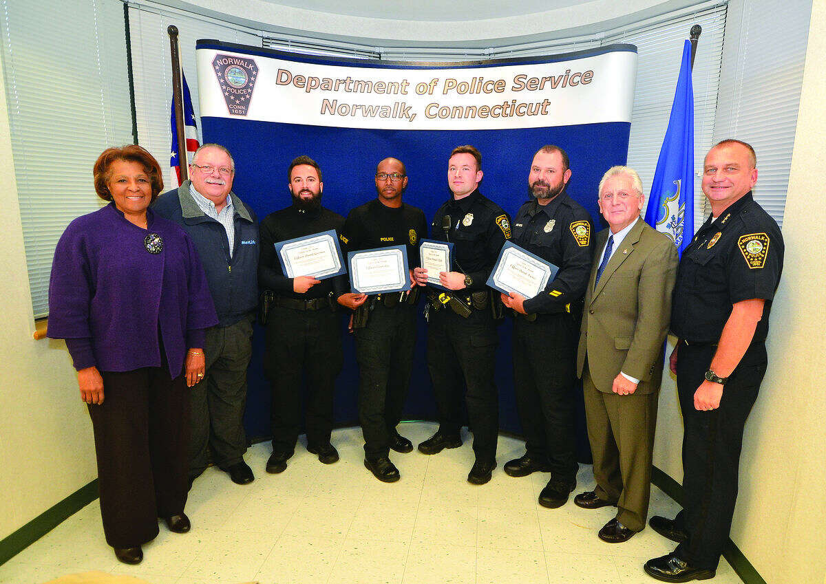 Hour Photo/Alex von Kleydorff Norwalk Police Department honor the October Officers of The Month L-R Commissioner Fran Collier Clemmons, Charles Yost, Officer David Geismar, Officer Owen Lee, Officer Daniel Sefcik, Officer David Nieves with Mayor Harry Rilling and Police Chief Tom Kulhawik