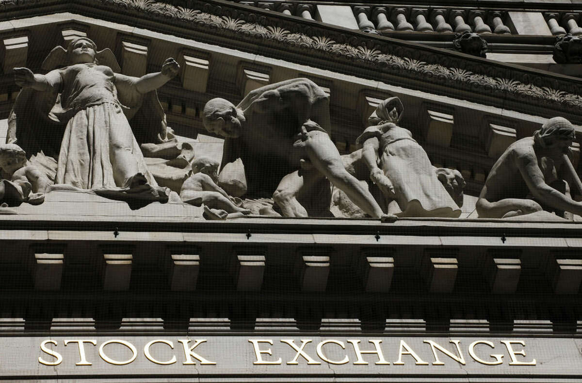 FILE - This July 15, 2013 file photo shows the New York Stock Exchange in New York. U.S. stocks are opening slightly higher Tuesday, Sept. 30, 2014, as investors set aside worries about the protests in Hong Kong. (AP Photo/Mark Lennihan, File)