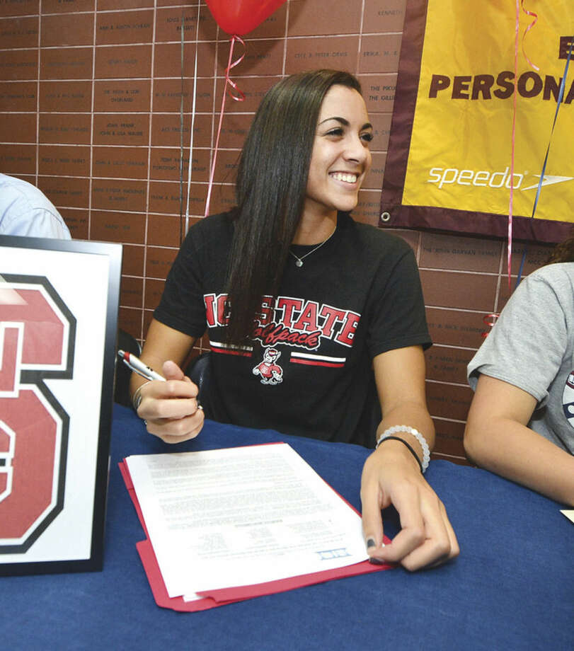 Hour photo/Alex von KleydorffKy-Lee Perry, a resident of Norwalk and senior at Brien McMahon High School, signs a letter of intent for swimming at North Carolina State. She is a member of the Wilton Wahoos swim team.