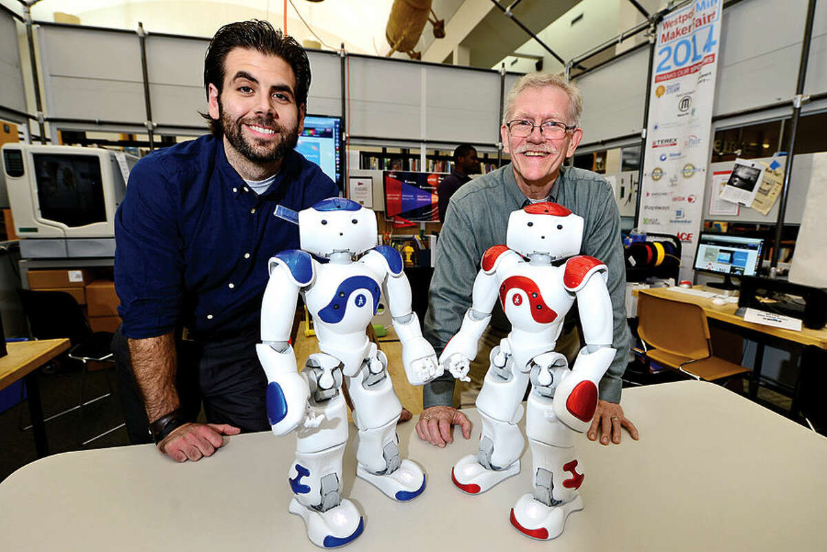 Hour photo / Erik Trautmann Westport Public Library manager of Digital Experience, Alex Giannini and Assistant Director of Innovation and User Experience, Bill Derry, show off their new acquisition, two Aldebaran humanoid robots, Vincent and Nancy. The robots can be programmed to do a variety of tasks and will be available to the public to help teach coding and programming skills.